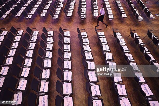 A conference worker walks past placards with the names of European rightwing leaders prior to a conference of European populist rightwing parties on...