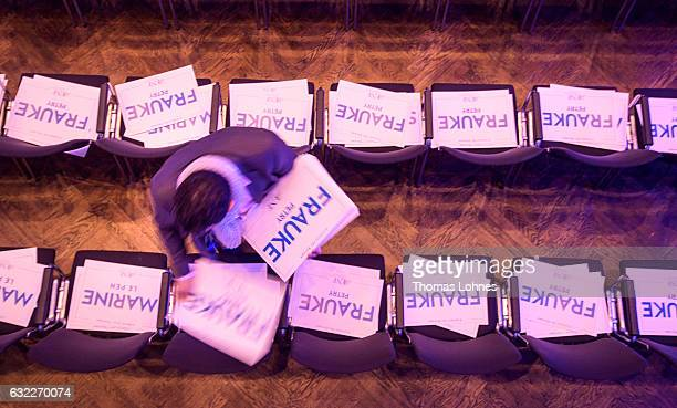 Conference workers place placards with the names of European rightwing leaders on chairs prior to a conference of European populist rightwing parties...