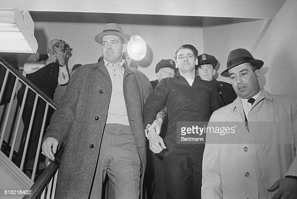 Confessed Boston Strangler Albert DeSalvo is led from a press conference at the Lynn police station after his capture in a West Lynn uniform store...