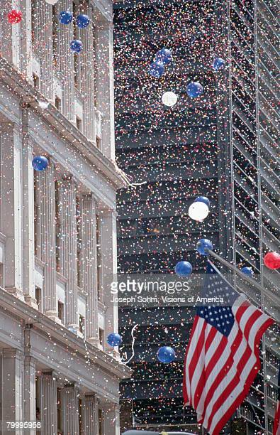 confetti and balloons at parade - ticker tape stock pictures, royalty-free photos & images