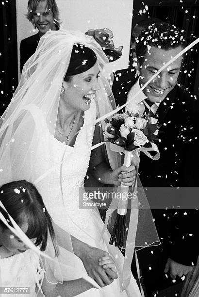 Confetti and streamers thrown on a newly married couple at their wedding (black and white)