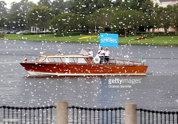 Confetti blasted from air cannons falls like sow during the ceremony for the official renaming of Downtown Disney as Disney Springs Tuesday Sept 29...