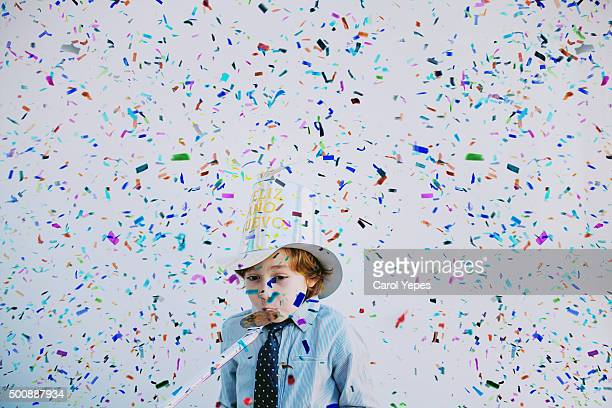 confetti boy - party blower stock pictures, royalty-free photos & images