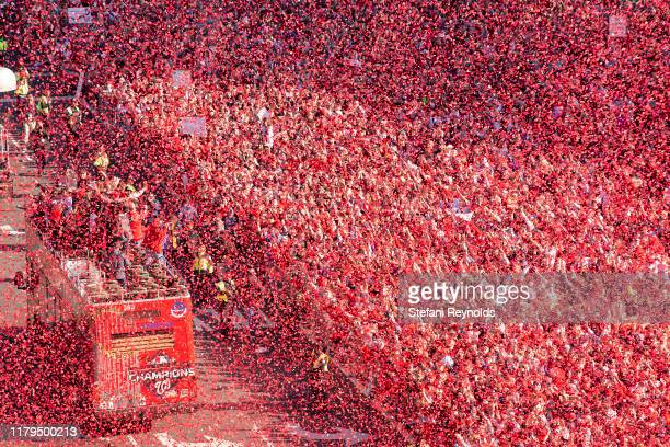 Confetti covers the crowd gathered for the Washington Nationals parade celebrating their World Series victory over the Houston Astros on November 2...