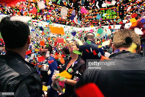 Confetti drops on traders and clerks in the Eurodollar trading pit at the CME Group's Chicago Board of Trade in Chicago Illinois US on Wednesday Dec...