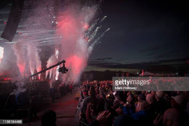 Confetti drops while Fatboy Slim performs onstage during Isle of Wight Festival 2019 at Seaclose Park on June 15 2019 in Newport Isle of Wight