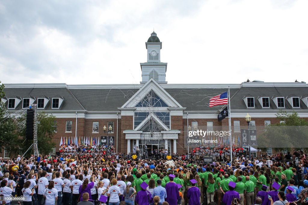 Confetti erupts after the ceremonial raising of the new school flag at the grand opening of the I Promise school on July 30, 2018 in Akron, Ohio. The new school is a partnership between the LeBron James Family foundation and Akron Public Schools.