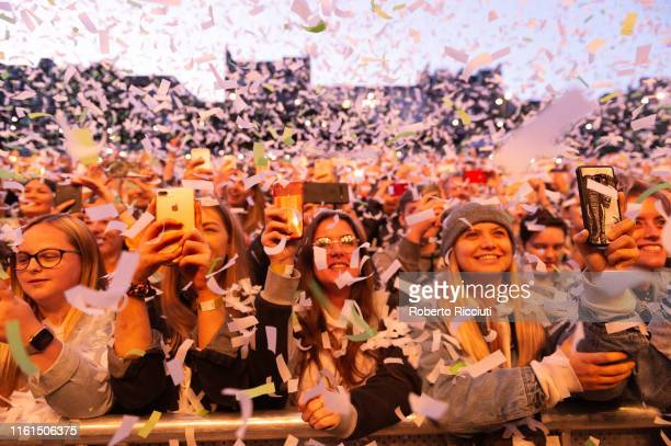 Confetti fall over the audience at the beginning of Lewis Capaldi's concert during Edinburgh Summer Sessions at Princes Street Gardens on August 13,...