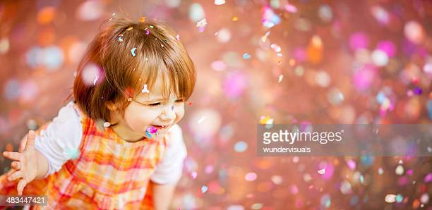 confetti falling down on happy girl - flying solo after party bildbanksfoton och bilder