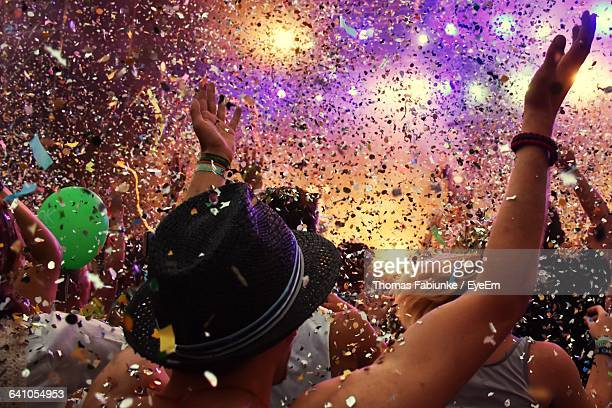 confetti falling on crowd at concert - festival goer stock pictures, royalty-free photos & images
