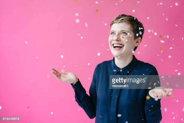 confetti falling on happy woman - down blouse stock pictures, royalty-free photos & images