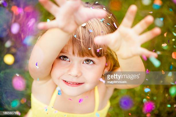 confetti falling on little girl - day stock pictures, royalty-free photos & images