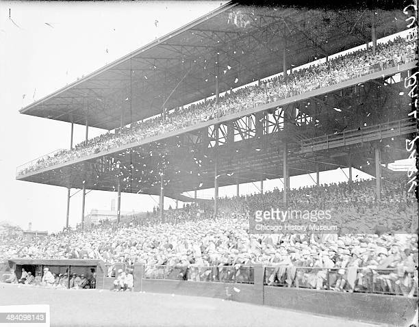 Confetti falling through the air above crowd sitting in the grandstands during a game involving the National League's Chicago Cubs at Wrigley Field...