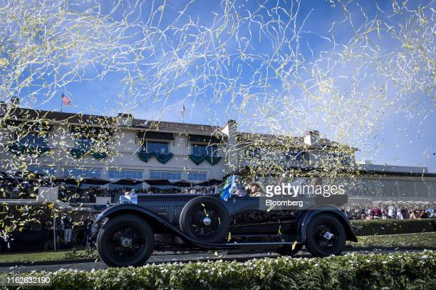 Confetti falls a 1931 Bentley 8 litre Gurney Nutting Sport Tourer, owned by Michael Kadoorie, chairman of Hong Kong And Shanghai Hotels Ltd., after...