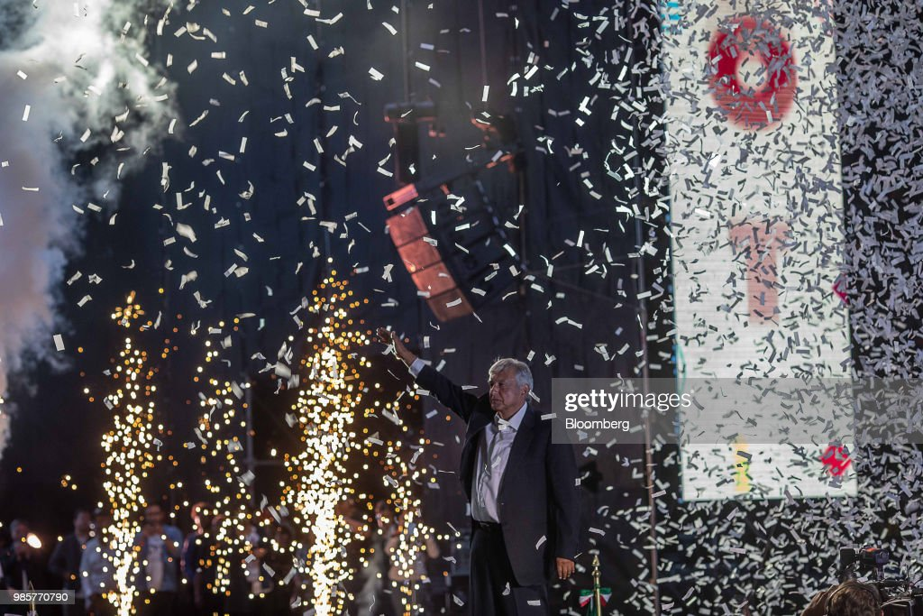 Confetti falls as Andres Manuel Lopez Obrador, presidential candidate of the National Regeneration Movement Party (MORENA), greets the crowd during the final campaign rally at the Estadio Azteca in Mexico City, Mexico, on Wednesday, June 27, 2018. Lopez Obrador promises to put the poor first with a raft of new social programs -- and to stand up to the U.S. President, who has been denouncing Mexico since before he got elected. Photographer: Alejandro Cegarra/Bloomberg via Getty Images