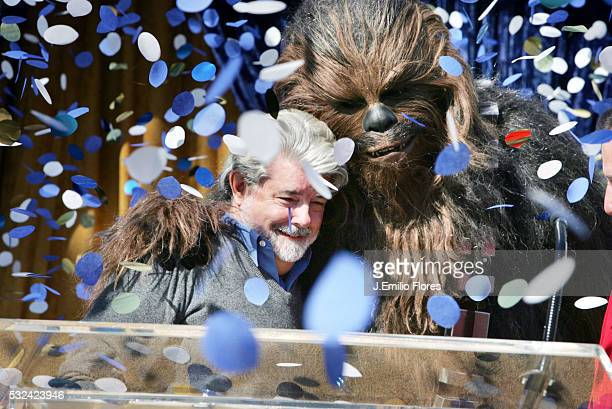 Confetti falls as Director George Lucas is congratulated by Chewbacca at a press conference announcing Lucas as the Grand Marshall for the 2007...