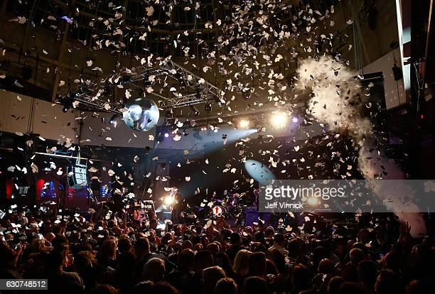 Confetti falls as the clock strikes midnight during the NHL Centennial Classic New Year's Eve Celebration at Muzik Event Center on January 1 2017 in...