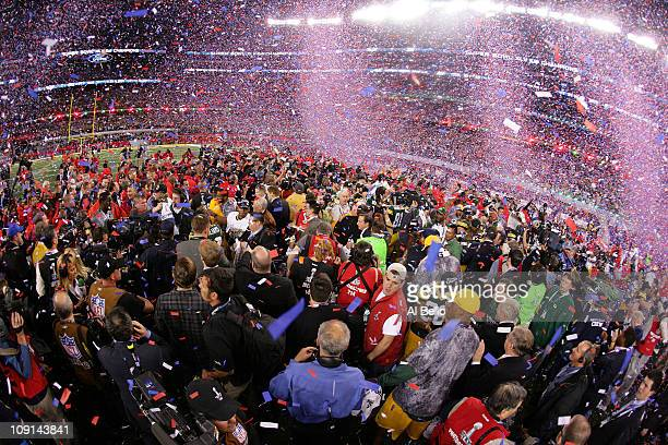 Confetti falls as the Green Bay Packers celebrate their 3125 win against the Pittsburgh Steelers during Super Bowl XLV at Cowboys Stadium on February...