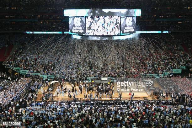 Confetti falls as the North Carolina Tar Heels celebrate after defeating the Gonzaga Bulldogs during the 2017 NCAA Men's Final Four National...