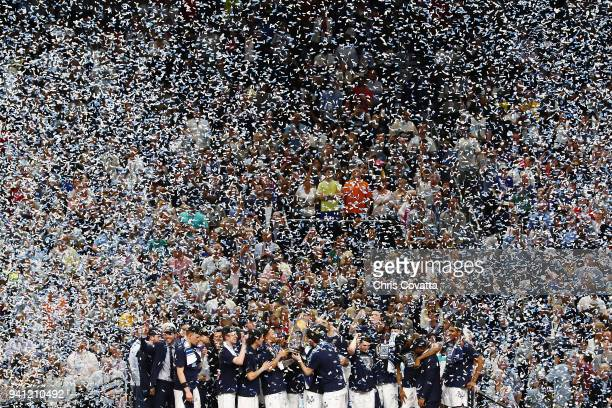 Confetti falls as the Villanova Wildcats celebrate after defeating the Michigan Wolverines during the 2018 NCAA Men's Final Four National...