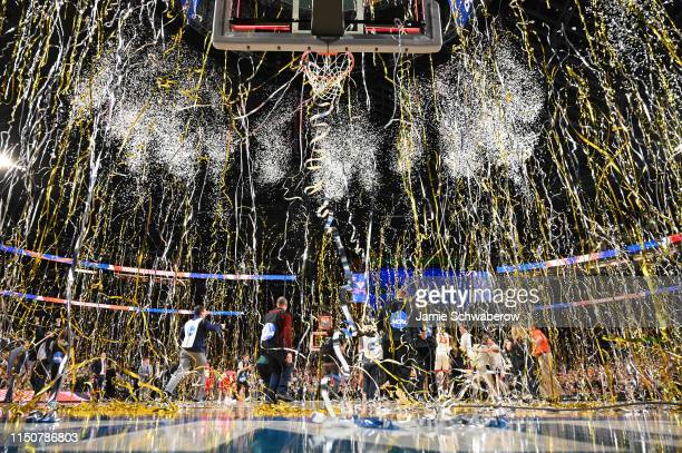 Confetti falls as the Virginia Cavaliers celebrate their victory over the Texas Tech Red Raiders during the 2019 NCAA Photos via Getty Images Men's...