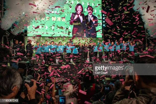 Confetti falls as Tsai Ing-Wen holds hands with Vice President-elect William Lai and Vice-President, Chen Chien-jen , as she celebrates after...