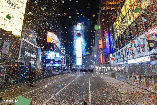 Confetti falls at midnight during a virtual New Year's Eve celebration in the Times Square area of New York, U.S., on Friday, Jan. 1, 2021. The...