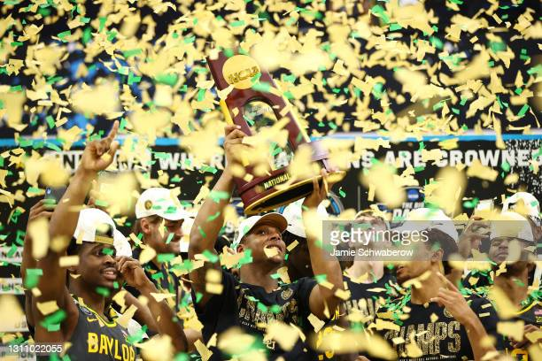 Confetti falls down on the Baylor Bears as they celebrate their win against the Gonzaga Bulldogs in the National Championship game of the 2021 NCAA...