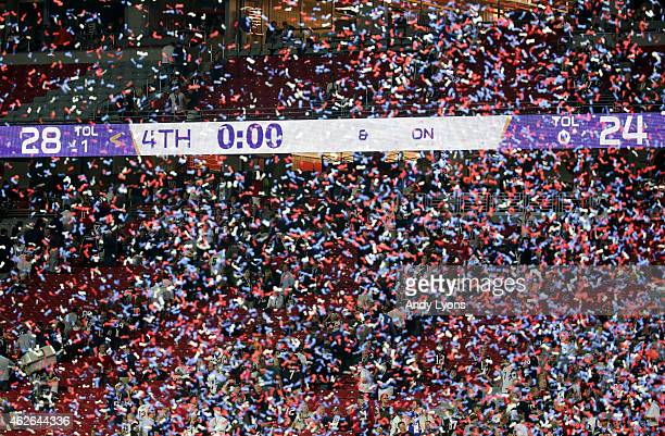 Confetti falls in front of the scoreboard as New England Patriots defeat the Seattle Seahawks during Super Bowl XLIX at University of Phoenix Stadium...
