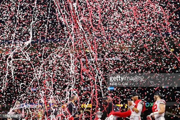 Confetti falls on head coach Ryan Day, Justin Fields and Tuf Borland of the Ohio State Buckeyes after they defeated the Clemson Tigers 49-28 during...