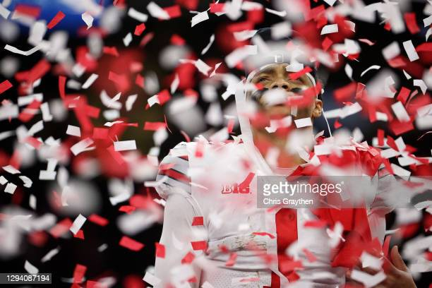 Confetti falls on Justin Fields after the Ohio State Buckeyes defeated the Clemson Tigers during the College Football Playoff semifinal game at the...