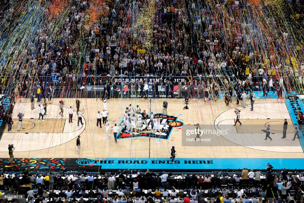 Confetti falls on the court after the 2018 NCAA Men's Final Four National Championship game between the Michigan Wolverines and the Villanova Wildcats at the Alamodome on April 2, 2018 in San Antonio, Texas.