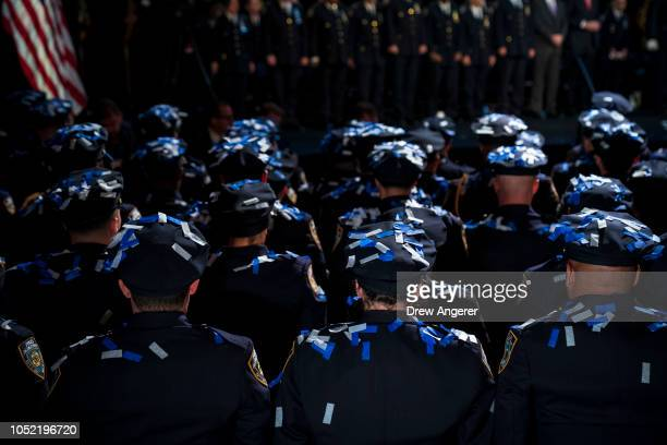 Confetti falls on the newest members of the New York City Police Department at the conclusion of their police academy graduation ceremony at the...