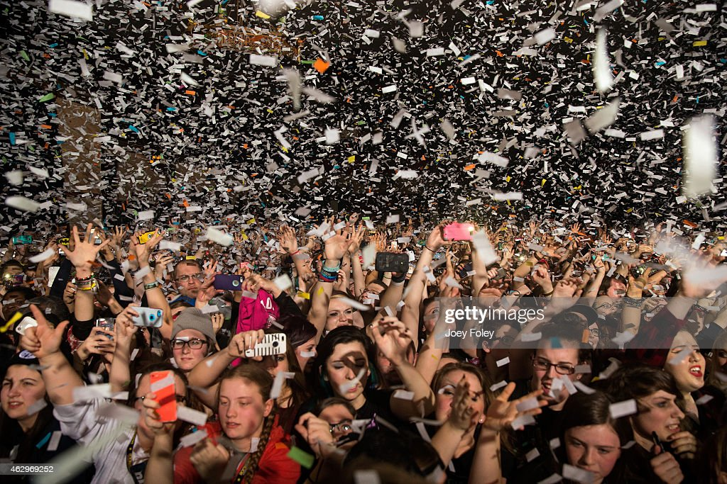 Confetti falls on the sold out crowd as Pierce The Veil starts their set in front of a sold out crowd at Egyptian Room at Old National Centre on February 7, 2015 in Indianapolis, Indiana.