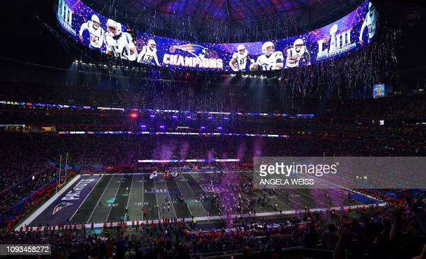 TOPSHOT Confetti falls onto the pitch after the New England Patriots won Super Bowl LIII against the Los Angeles Rams at MercedesBenz Stadium in...