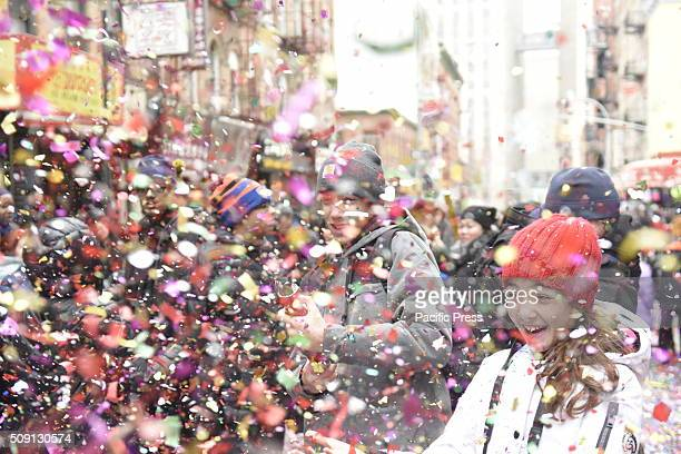 Confetti fills the air on Mott Street as people fire off confetti cannon Much of Lower Manhattan came alive in sound and color as the Year of Monkey...