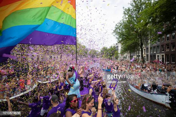 Confetti flies as revellers on the COC Netherlands boat the oldest still active LGBTIorganisation in the world parade in the traditional Canal Parade...