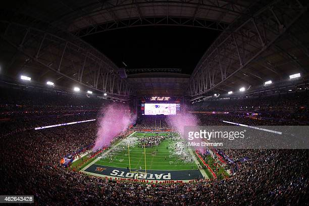 Confetti flies as the New England Patriots defeat the Seattle Seahawks during Super Bowl XLIX at University of Phoenix Stadium on February 1 2015 in...