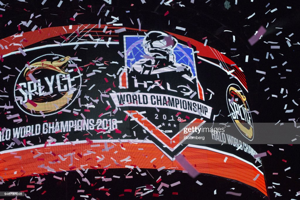 Confetti flies in front of a screen displaying the logo of team Splyce after the team wins the Halo World Championship finals in Seattle, Washington, U.S., on Sunday, April 15, 2018. E-sports revenue, consisting of merchandise, event tickets, sponsorships, advertising and media rights -- all beyond game sales -- is expected to rise at a 32.2% average annual rate in 2016-20 to $1.5 billion in 2020, according to Newzoo. Photographer: David Ryder/Bloomberg via Getty Images