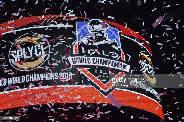 Confetti flies in front of a screen displaying the logo of team Splyce after the team wins the Halo World Championship finals in Seattle Washington...