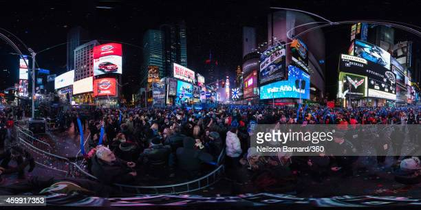 Confetti flies onto the crowds during The New Year's Eve 2014 Celebration in Times Square on January 1 2014 in New York City
