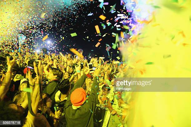Confetti flies over festival goers as Tame Impala perform onstage at Which Stage during Day 2 of the 2016 Bonnaroo Arts And Music Festival on June...