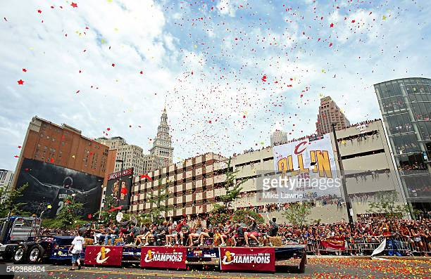 Confetti flies over the parade route during the Cleveland Cavaliers 2016 NBA Championship victory parade and rally on June 22 2016 in Cleveland Ohio