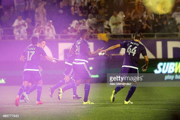 Confetti flies through the air as Cyle Larin of Orlando City SC celebrates with teammates after he scored a goal with his head during a MLS soccer...