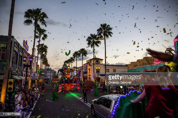 Confetti flies while parade participants throw beads during Universal's Mardi Gras parade on February 22 2019