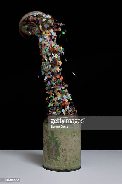 Confetti flying out of an old-fashioned metal tin