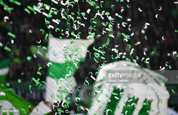 Confetti from Wolfsburg fans hangs in a net during the Bundesliga match between VfL Wolfsburg and SC Freiburg at Volkswagen Arena on April 5 2017 in...