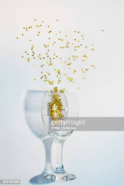 Confetti in the shape of stars poured out of glasses