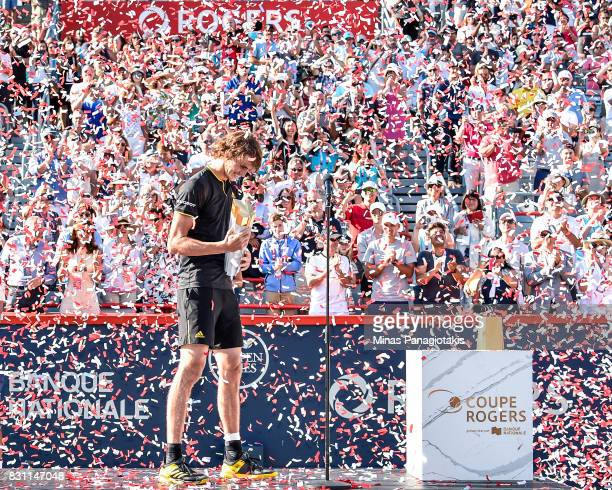 Confetti is blown as Alexander Zverev of Germany makes his way onto the stage with the trophy after defeating Roger Federer of Switzerland 63 64 in...