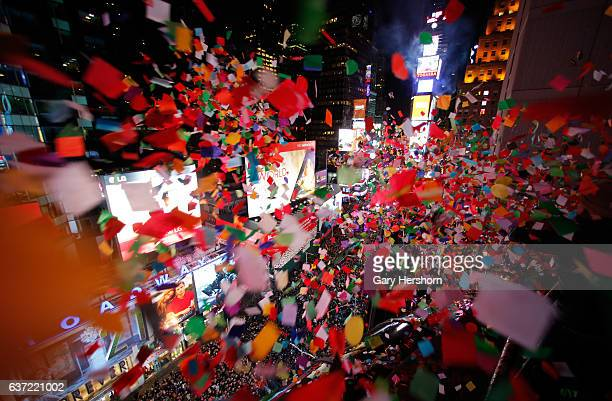 Confetti is dropped on revelers during New Year's Eve festivities in Times Square on January 1 2017 in New York City